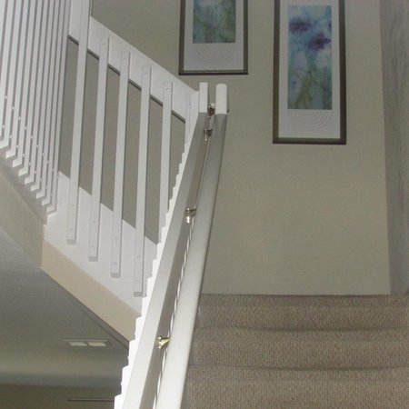 Coral Cay Resort : Stairs to 2 bedrooms & a game room