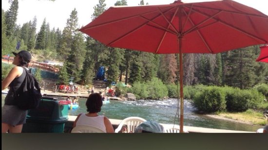 Tahoe City - South/North Trailheads: In the comfort of the patio bar on the dock, one can watch the rafting crafts struggling through