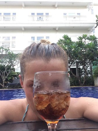 Frangipani Villa Hotel, Siem Reap: the rooms behind me! drinking in the pool!