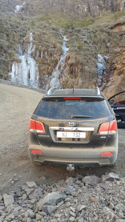 Sani Pass: Driving up next to the frozen waterfall.