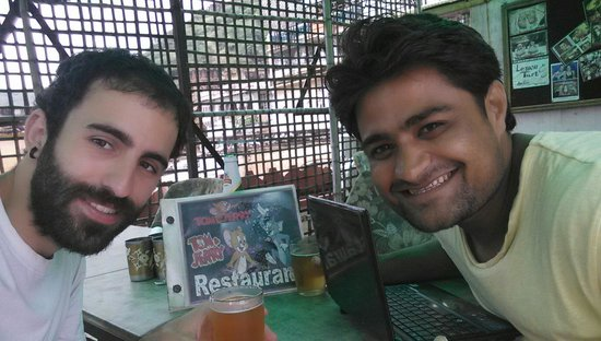 Tom and Jerry Restaurant.: Sharing a beer with Tom, one of the owners!