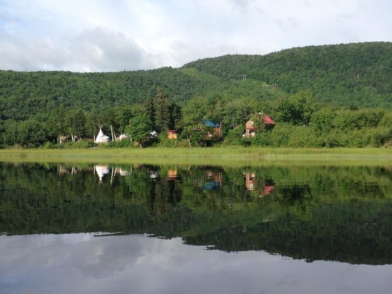 Cabot Shores Wilderness Resort and Retreat: View of Cabot Shores chalets, yurts, teepee, and lodge from the lake