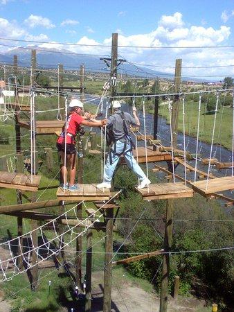 Noah's Ark Colorado Rafting & Aerial Adventure Park: Noah's Ark staff member talks Dave (blind) acrros the aerial park.