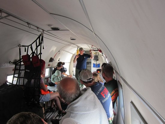 Aerial Fire Depot and Smokejumper Center: On board the airplane hearing about jumping from the plane