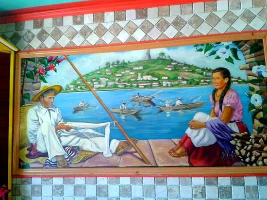 El Lugarcito Restaurant: Idyllic wall decor.