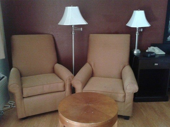 Super 8 King City : Comfortable chairs with adequate light and outlets [and a desk and chair, not shown, are in room