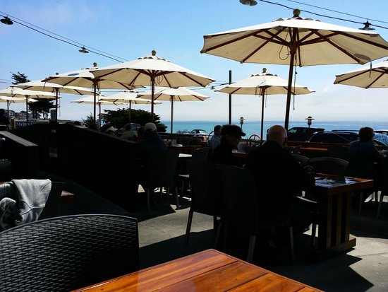 Moonstone Beach Bar & Grill : View of the patio, with the ocean just beyond its edge