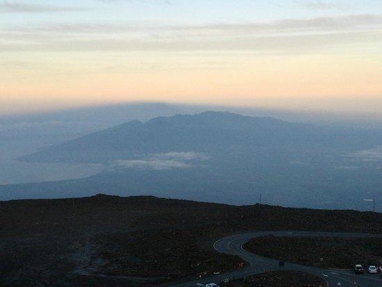 Haleakala National Park: West Maui Mountains from top of Haleakala at sunrise