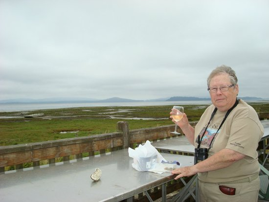 Oysterville Sea Farms: Ruthy having wine and oysters overlooking the bay