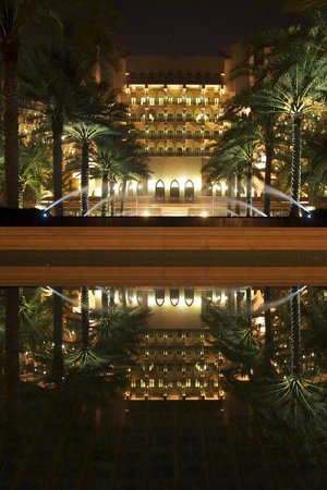 Al Bustan Palace, A Ritz-Carlton Hotel: A view of the hotel at night when the pool becomes a water feature.