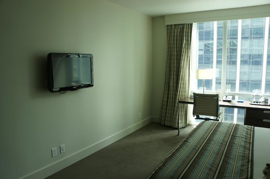 Coast Coal Harbour Hotel by APA: tiny tv on a big white wall