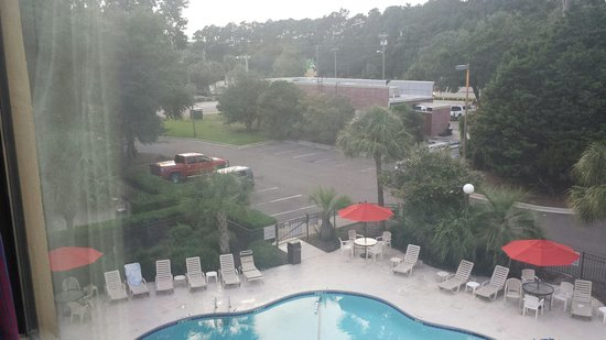 Red Roof Inn Myrtle Beach Hotel - Market Commons: Looking out from the room over pool