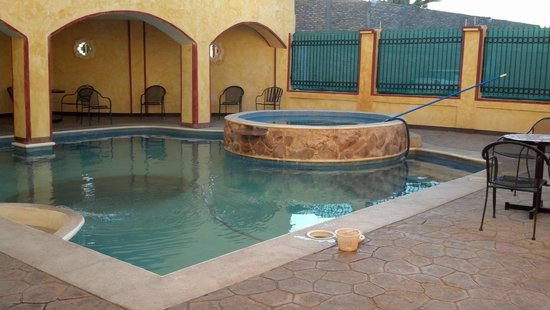 Hacienda Los Algodones: Pool area with lots of tables and chairs...smoking allowed.