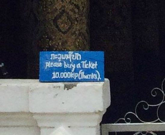 Wat Mai Suwannaphumaham: Please pay here