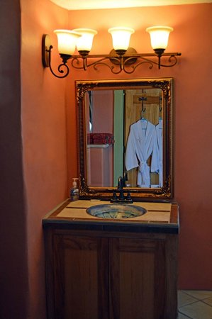 Fire Water Lodge: Datura room: hand made ceramic sink, view of robes