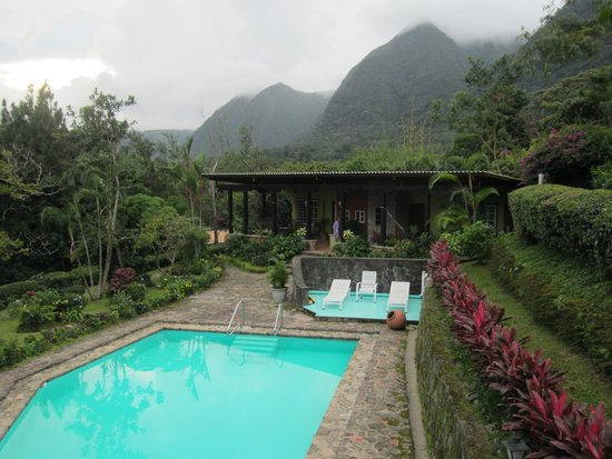 The Golden Frog Inn: The pool, the rooms and the mountains beyond.
