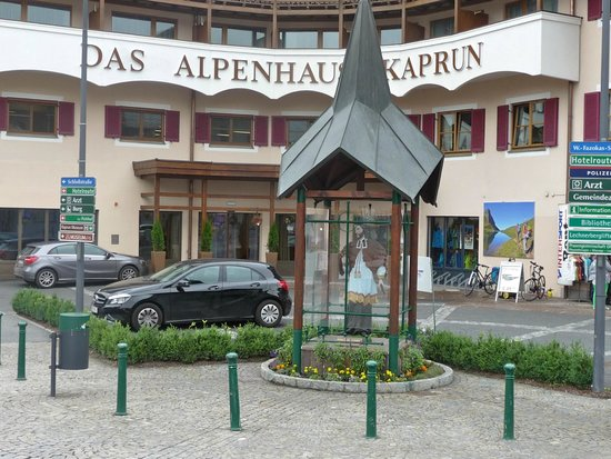 Das Alpenhaus Kaprun: The hotel entrance- the saint protects the river bridge.