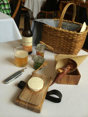 Eleven Madison Park : Best picnic basket / cheese course ever.  Chevre-style cow's milk cheese with parsley honey spre