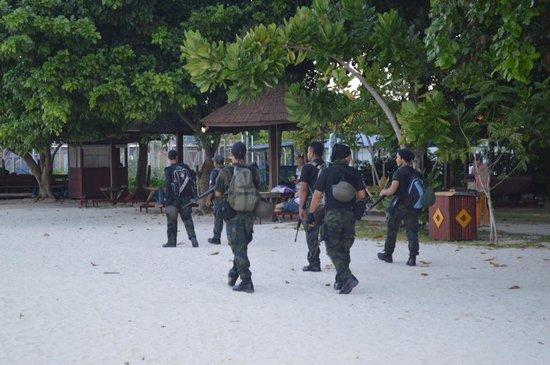 Scuba Junkie Mabul Beach Resort : Police guards