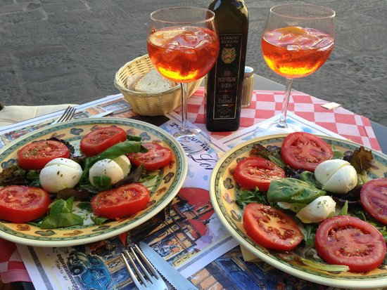 Trattoria San Lorenzo: The most delicious caprese salad and wickedly good Aperol spritz!