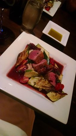 Caroline's Restaurant: Duck with zucchini, tomatoes, and mashed potatoes.
