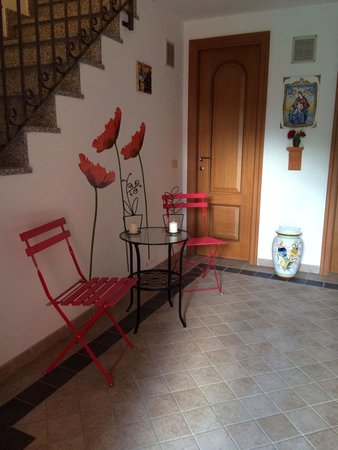 Cute foyer - stairwell leading up to apartments - Picture of Bed and ...