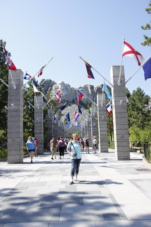 Mt. Rushmore Black Hills Gold Factory Tour: sister standing in the avenue of Flags