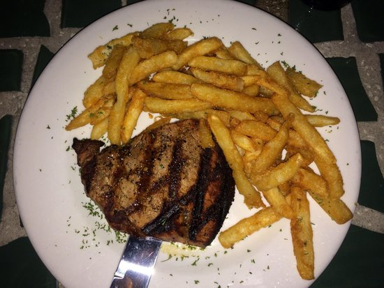 O.C. White's Seafood & Spirits : Filet Mignon with fries. It was so tender, it started falling apart when I was cutting it!