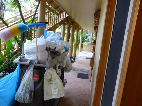 Sanctuary Rarotonga-on the beach: The cleaners trolley takes up most of the walkway