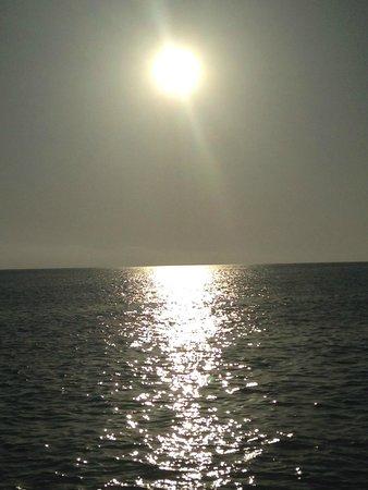 Cala Saona: Atardecer desde el catamaran