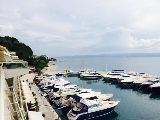 Le Meridien Lav Split: Marina next to the hotel with boats for rent, water sports, and shops. Not a bad view from the p