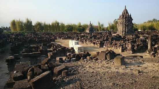 Candi Sewu : mounds of debris and materials for the restoration