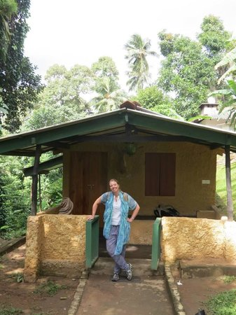 The Kandyan Manor: outside our little bungalow/ room