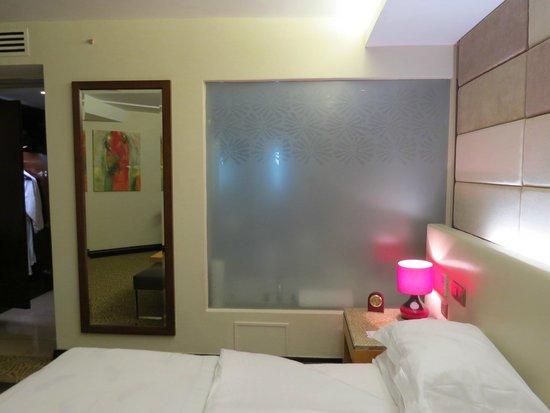 The Boma Nairobi: The glass wall to the bathroom
