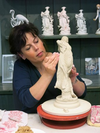 Porzellan-Manufaktur Meissen: A sculptress working on a traditional Meissen figure.