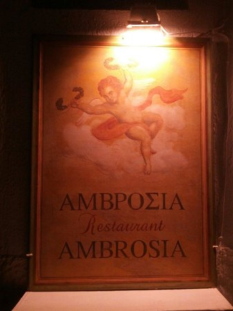 Ambrosia Restaurant: The sign looks like artwork hanging on the outside corner of the building