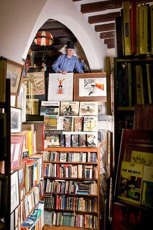 English Book shop: Owner looks down TOP HATTED
