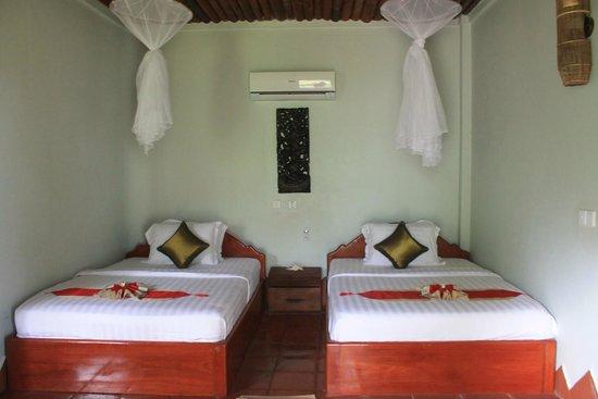 blue kep bungalow : chambre lit twin