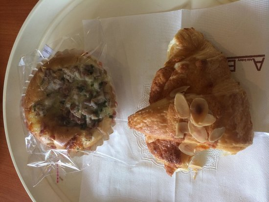 ABC Bakery & Cafe: Half eaten almond croissant and cheesy jambon bun, really tasty!
