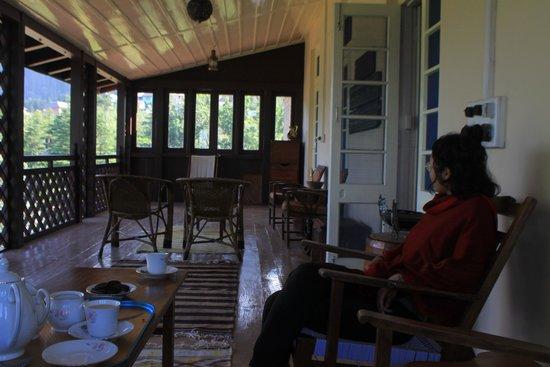 Deodar Manor: enjoying tea on the balcony