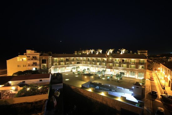 Playa Calera : Hotel exterior at night seen from neighbouring building
