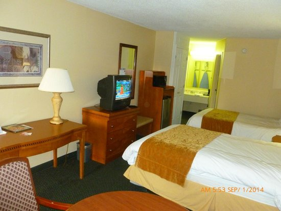 Econo Lodge Inn & Suites - Williamsburg: View of golden brown furn. hard to see dark inlay but there. Lrge fridge under micro-wave in cab