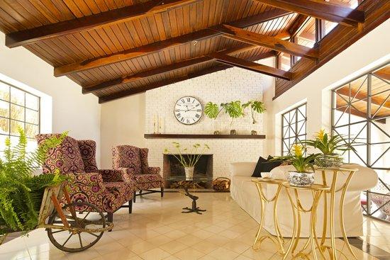 Villa San Ignacio: Lobby fireplace