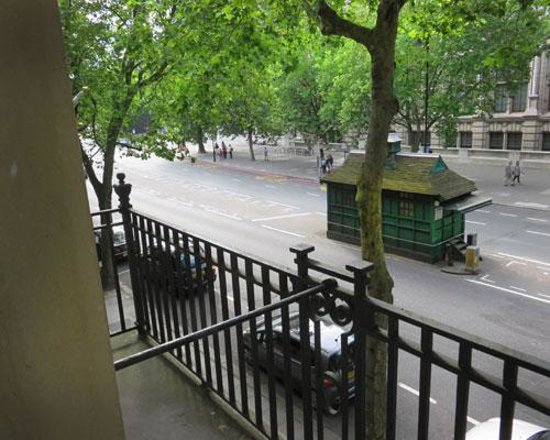 The Rembrandt : View out the french door. Love the little coffee shack for the taxi drivers.