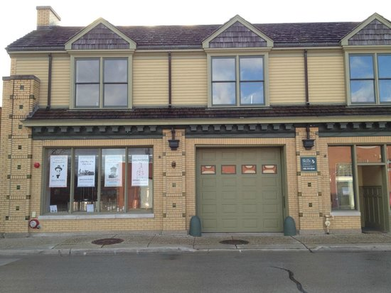 Riverside, IL: Quincy Street Distillery storefront in 1912 arts & crafts industrial building.