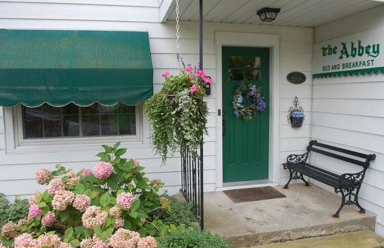 The Pentwater Abbey Bed and Breakfast: A pretty porch welcomes you!