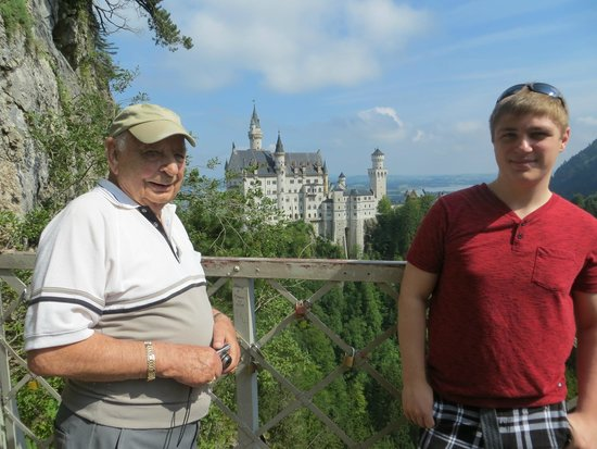 European Castles Day Tours: Dad and son on Mary's Bridge overlooking Neuschwanstein Castle