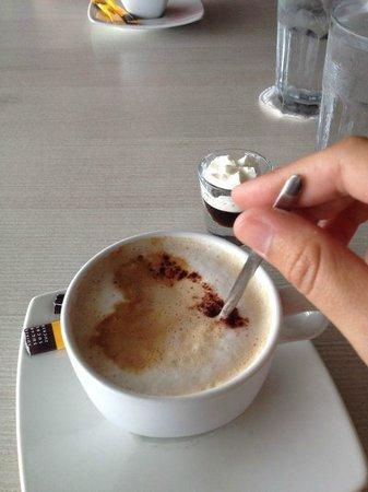 Taste of Belgium Restaurant: Yummy Cappuccino, cake and little glass of coffee liquor.