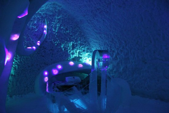 Icehotel: Ice hotel bed with lights in the ice