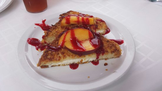 Harry's Roadhouse : Corn flake crumbed french toast stuffed with marscapone and garnished with fresh peaches and a r